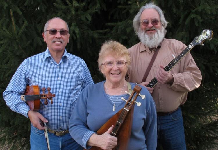 The Highlander String Band - Jim Gaskins on fiddle, Phyllis Gaskins on Appalachian lap dulcimer and Gene Bowlen on clawhammer banjo.